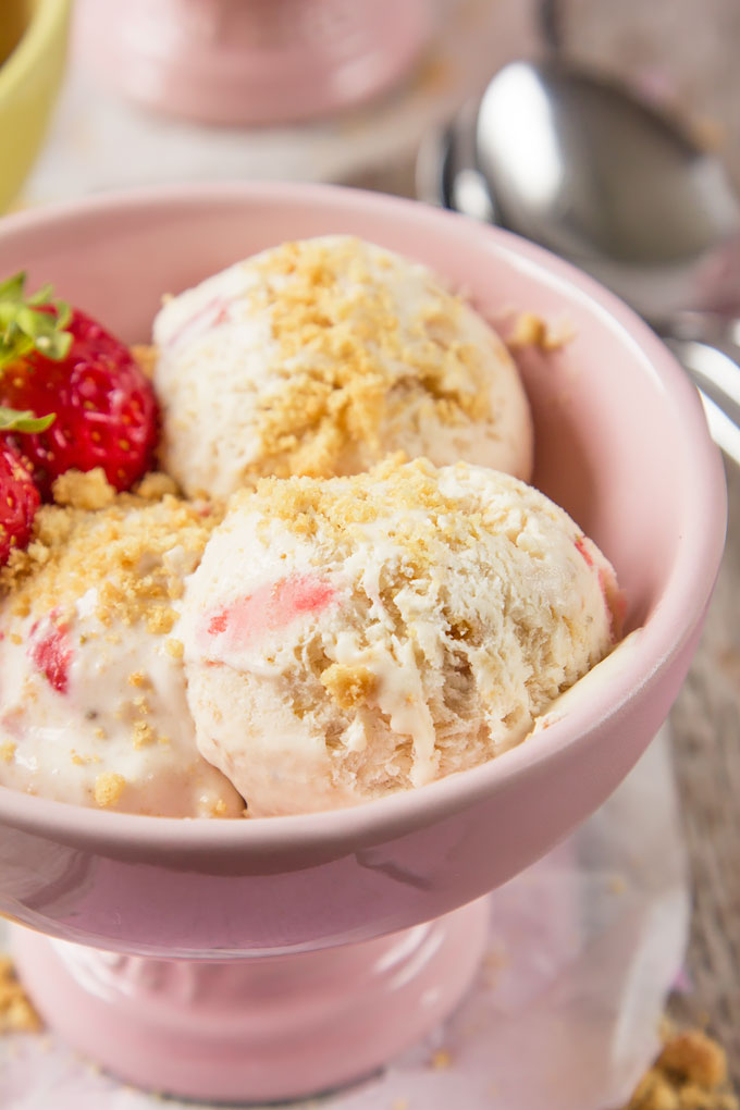 Craving decadent homemade ice cream, but don't have an ice ream machine? Then try my Strawberry Shortcake Ice Cream! Five ingredients, full of fresh strawberries, crumbled biscuits and ready in a few hours with no churning; the perfect summer ice cream!
