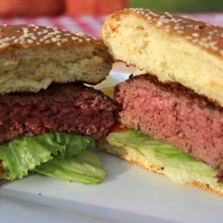 Burger Grilling: Learn how to grill perfect hamburgers with the 5-6-7 Grilled Burger Method. These tips for buying, mixing, shaping, and grilling your backyard burgers are fool proof.