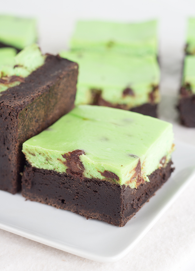 Mint Chip Cheesecake Brownies - fudgy brownies with a layer of mint cheesecake that's packed full of mini chocolate chips.