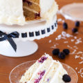The PKP Way | A cake for all occasions, this Blackberry Coconut Cake has a dense and moist crumb of blackberries and coconut, is filled with rich coconut buttercream, and frosted with tangy cream cheese frosting. Perfect for berry and coconut lovers everywhere.