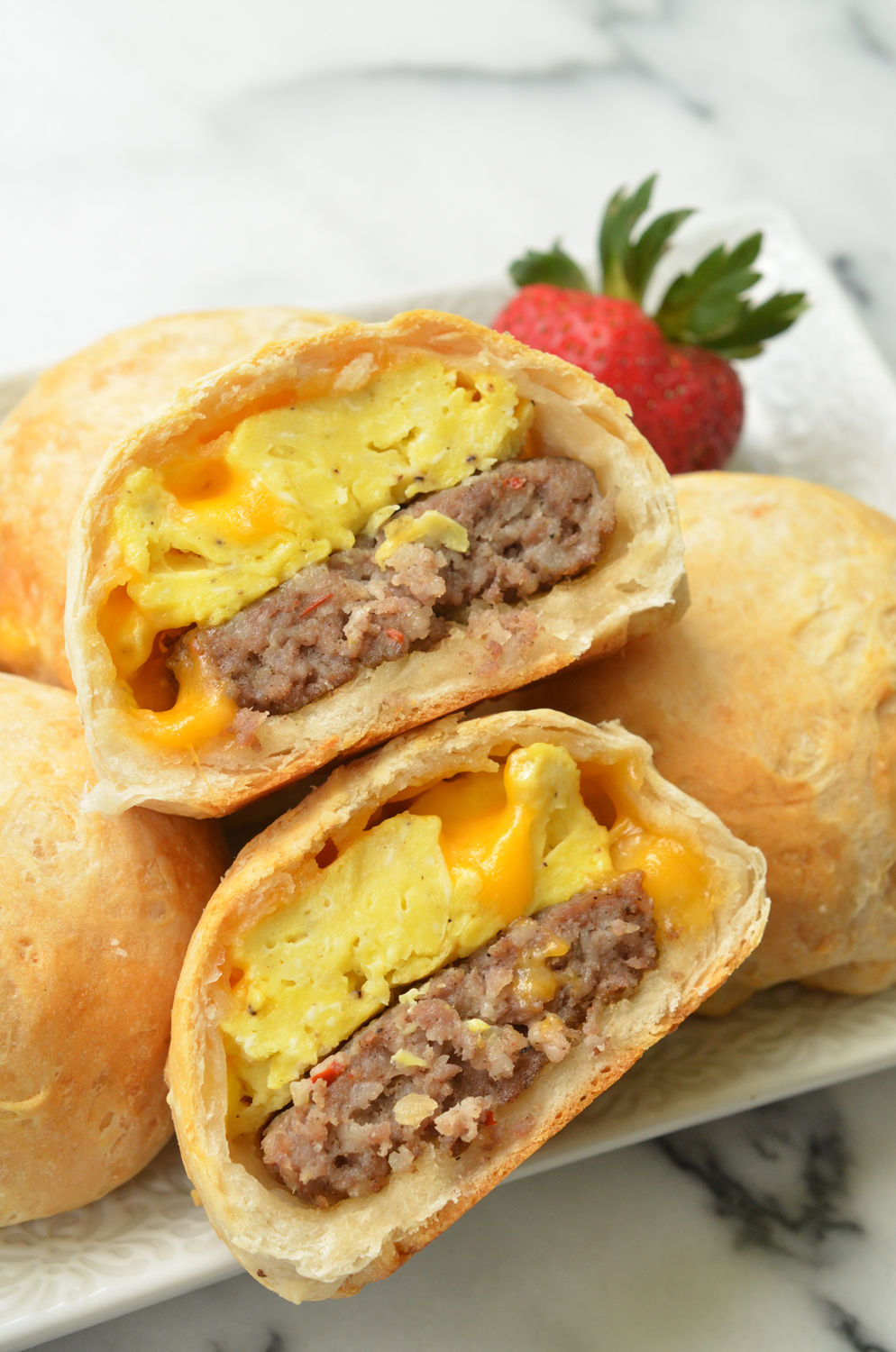 These 5-ingredient Sausage Egg Stuffed Breakfast Biscuits make mornings less hectic. This make-ahead breakfast is an easy recipe that makes meal prep a snap.