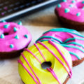 Baked chocolate cake doughnuts covered with a pop of colorful toppings make these Spooktacular Chocolate Doughnuts the perfect treat or your Halloween dessert table.