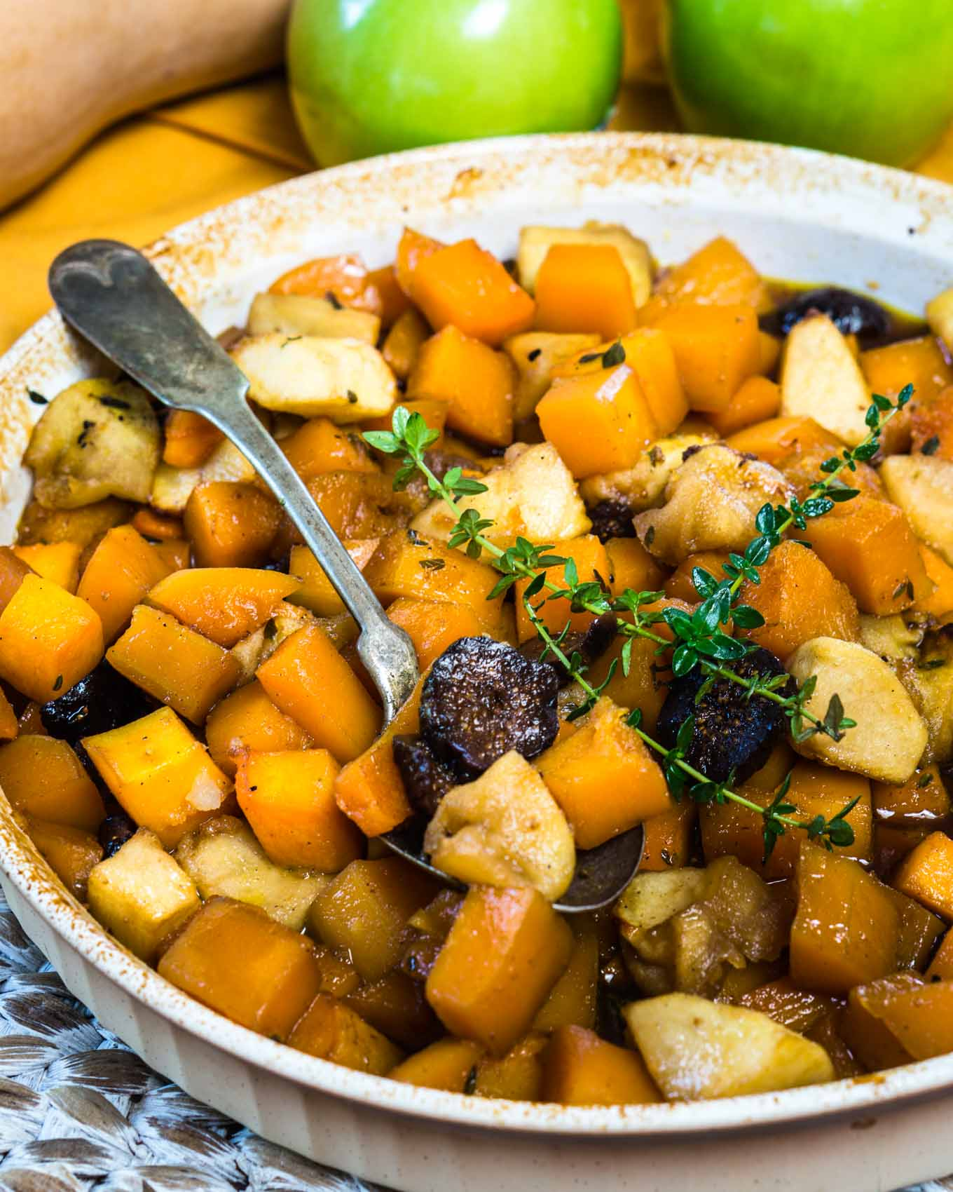 Baked Butternut Squash with Apples and Figs is warm, sweet, and buttery.  It tastes like it's loaded with fat and calories but neither one is welcomed in this dish. It's perfect for a casual dinner or dressed for the holidays because it's easy to put together and everyone will love it. | HostessAtHeart.com
