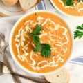 This 30-Minute Carrot Ginger Soup is pure comfort food full of all of your favorite fall flavors. This cheap healthy meal is the perfect quick weeknight dinner.