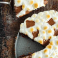 This blissful Campfire Inspired S'mores Dessert Pizza recipe is just what your family needs when they long for late summer days and sweet, gooey treats.