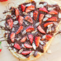 Combine your love of pizza and dessert with this incredibly delicious Chocolate Strawberry Flatbread Pizza recipe. Made with luscious chocolate spread, fresh berries, and slivered almonds, it is sure to be a family favorite.