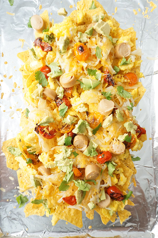 Breakfast meets dinner in these Loaded Breakfast Nachos perfect for special occasions or Sunday Brunch. Eggs, chicken hot dogs, cheese, avocado, tomatoes, and hash browns piled high on tortilla chips!