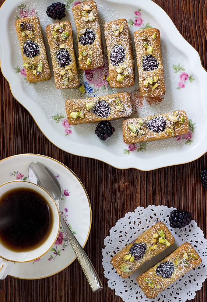 Financiers are traditional bite-sized French treats. Made with pistachio and almond flour, these French Financiers with Blackberries are an attractive dessert that's a melt-in-your mouth delight.