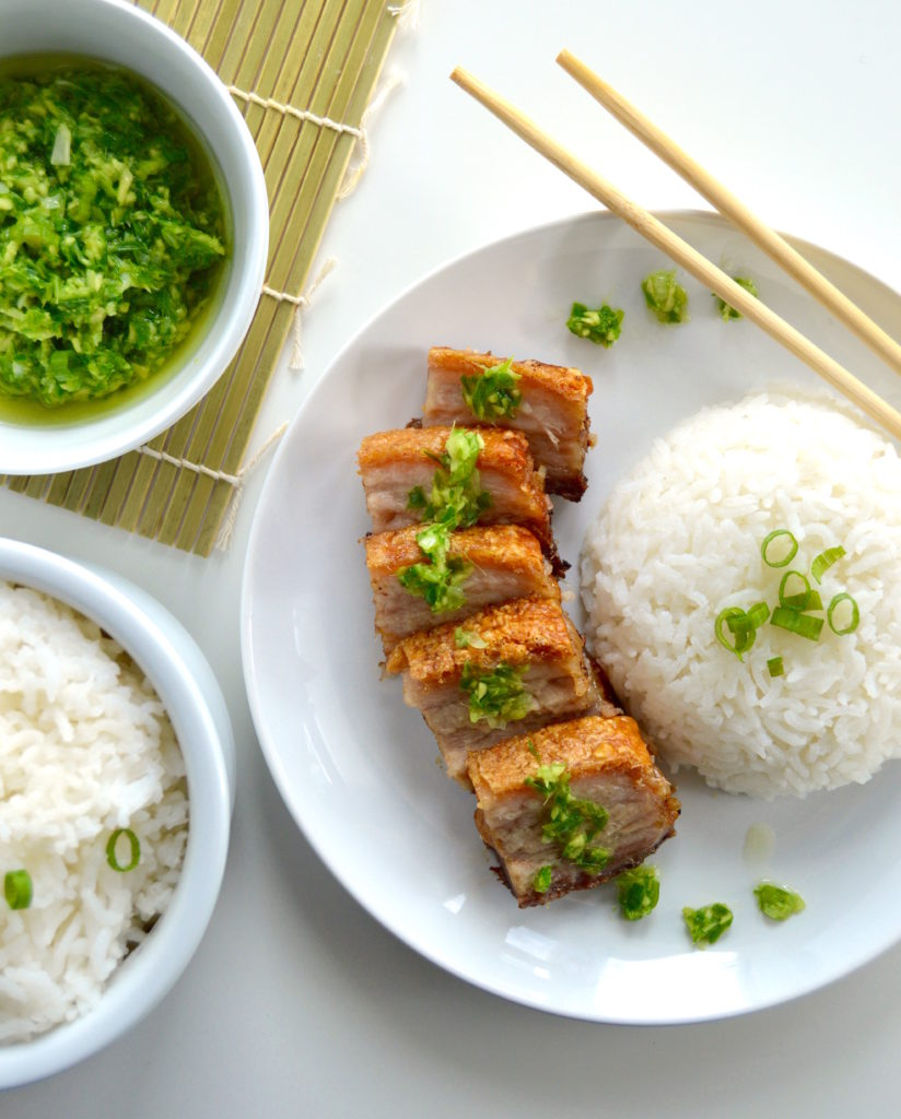 This Hong Kong Style Crispy Pork Belly is marinated in the fridge, tenderized, and then baked in the oven under a layer of coarse salt. Paired with simple white rice and an amazing ginger green onion sauce, this is an all-star dinner idea!