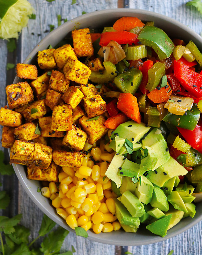 This Spiced Tofu Veggie Buddha Bowl is super easy to pull together and an array of spices ensure that this bowl is super tasty too. This mix of beautiful colors and vibrant flavors is divine!