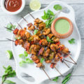 Very flavorful Smoky Grilled Chicken Tikki Kebabs are a perfect appetizer to please the crowd. Chicken chunks with vegetables marinated in a rich sauce and grilled to perfection on skewers.