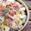 Dill pickles, bacon, and salami are essentials for this Meaty Dill Pickle Potato Salad. This spectacular summer salad will be the talk of the party!