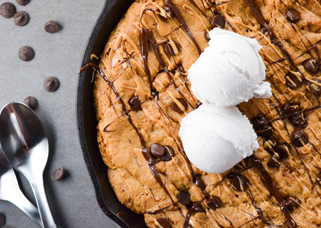 If you have been searching for a tasty, vegan, and gluten-free dessert to share with friends, stop right now! This GF Stuffed Chocolate Chip Cookie Skillet full of peanut butter and chia seeds has your name written all over it.