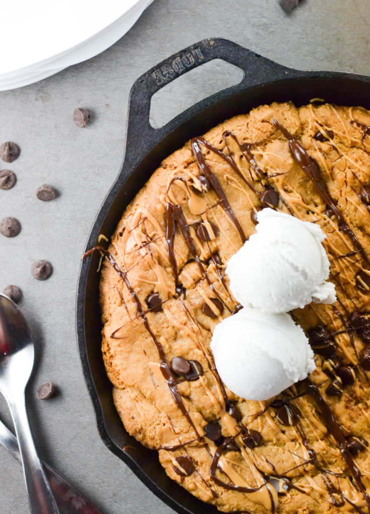 This Stuffed Chocolate Chip Cookie Skillet full of peanut butter is the perfect vegan and gluten free dessert to share with friends this weekend.