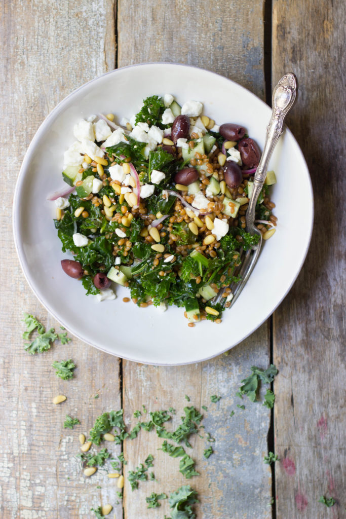 Satisfy your hunger the healthy way when you enjoy this super simple Mediterranean Wheat Berry Salad full of seasonal vegetables, feta, and a light vinaigrette. This is an amazing summer salad that you just need to try!