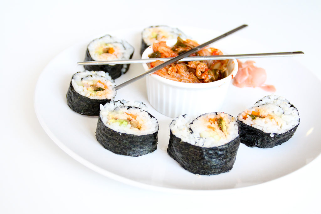 This Korean classic is a sure-fire hit at parties or at the dinner table. This is simply the best Kimchi Sushi Roll recipe you'll ever try. Easy to make and full of flavor, you need this recipe in your life!