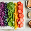 You will love how this colorful Rainbow Summer Salad recipe comes together with the odds and ends from your refrigerator. Let us show you just how well you can eat even while away on vacation!