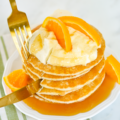 These Crepe Suzette Inspired Pancakes or Suzette Shortstacks is a recipe inspired by one of home cooking's greatest heroes, Julie Child. Combine the luscious flavors of citrus and liqueur for an elegant Sunday brunch!