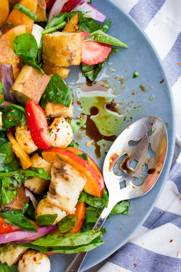 Farmers Market Basil Peach Panzanella Salad is a tuscan salad with a twist. This 20-minute dish is perfect for lunch or as a dinner side or outdoor potluck.