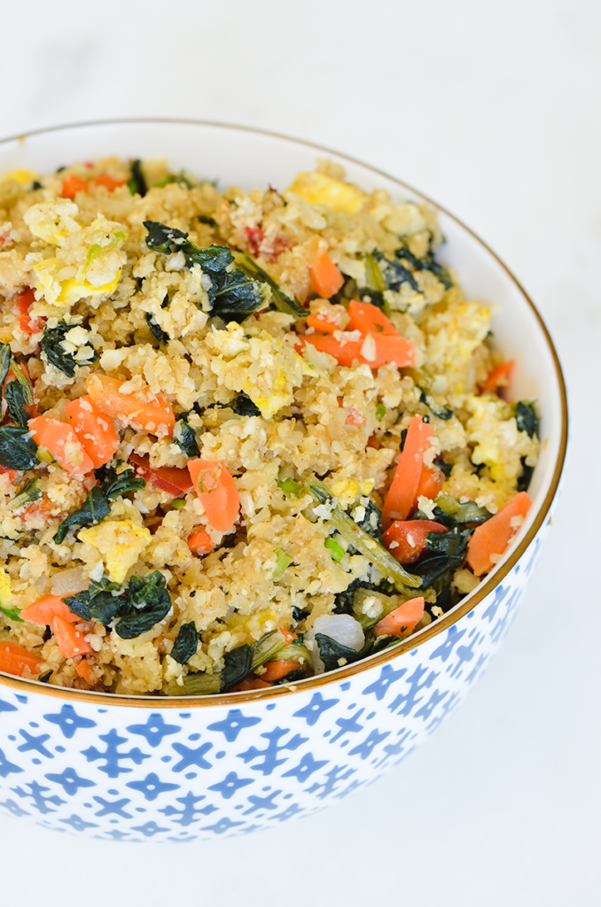 Asian-Inspired Cauliflower Fried Rice is made with classic flavors and healthy ingredients. This healthier classic is low carb and as good as take out.