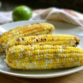 This Grilled Maple Lime Corn on the Cob recipe loaded with sweet and tangy flavors is a foil-wrapped grill recipe perfect for late summer get togethers.