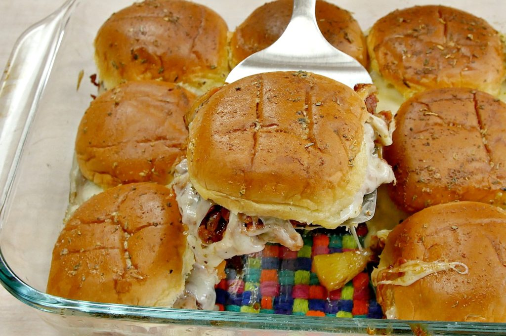 Everyone will be cheering for the one who serves these Game Day Hawaiian Pizza Sliders at half-time! Is it a pizza? Is it a sandwich? Who cares? Either way, this is the ultimate tailgate appetizer!