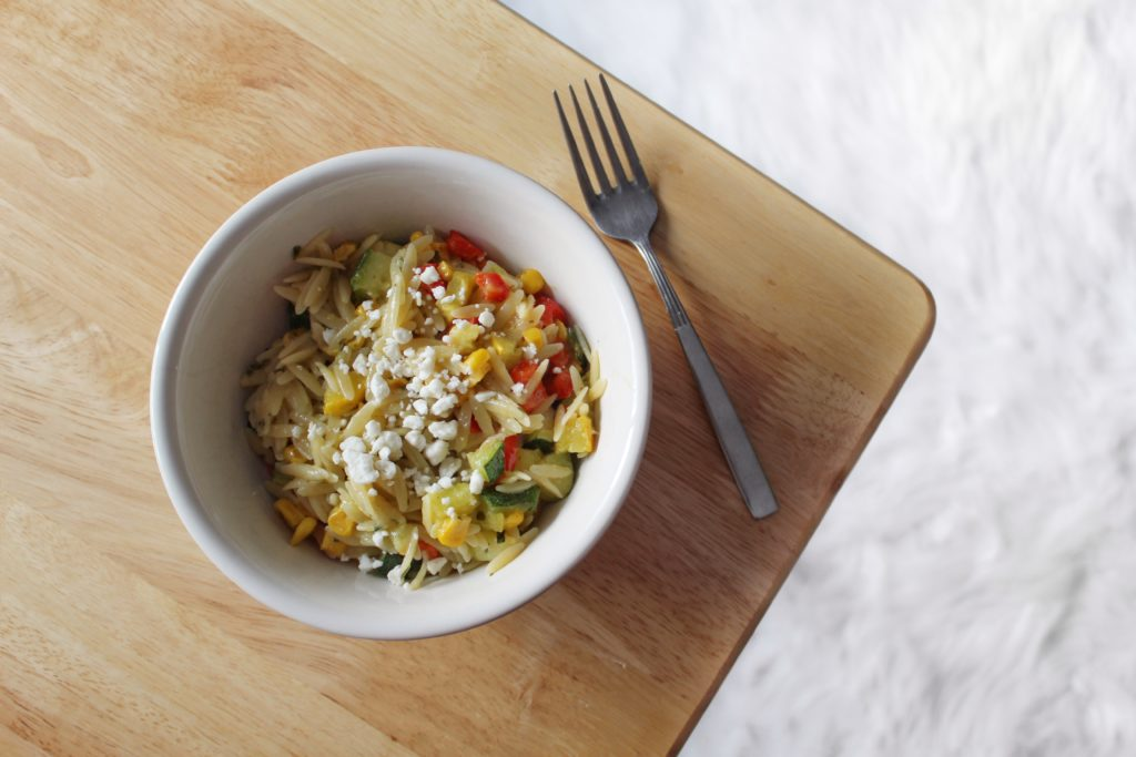 Whip up this quick and easy Roasted Vegetable Lemon Pepper Orzo recipe then add a sprinkle of feta cheese for a delectable side dish or a tasty lunch on the go!