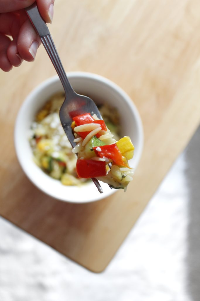 Whip up this quick and easy Roasted Vegetable Lemon Pepper Orzo recipe with a sprinkle of feta cheese for a delectable side dish or a tasty lunch on the go!