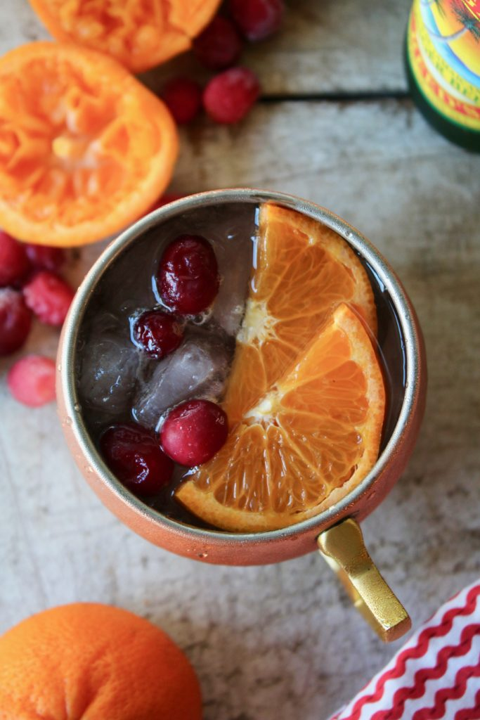Looking for a refreshing holiday drink? Grab a copper mug and make this amazing Cranberry Orange Moscow Mule! Zesty, fresh and delicious; this cocktail is exactly what your party needs.
