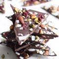 Tis almost the season for gift giving and what better way to surprise someone than with the gift of food? These five Festive Chocolate Bark recipes are perfect for gift giving or your party table!