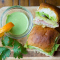 These savory little Cilantro-Citrus Aioli Cuban Sliders are perfect hand warmers for a cool autumn tailgate. These baked small bites pack a powerful flavor punch that's sure to be a crowd pleaser!