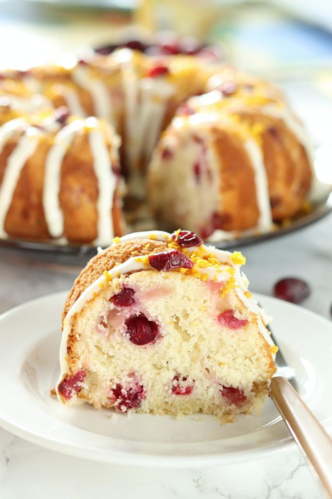 Celebrate fall with this moist, tender White Chocolate Orange Cranberry Cake. Flavored with fresh orange zest and studded with fresh red cranberries, it's the perfect balance of sweet and tart flavors with a white chocolate glaze!