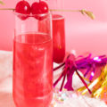 Ring in the new year with this Swirled Cranberry Champagne Cocktail made with grenadine, cranberry juice, and champagne that swirls and shines thanks to a secret ingredient!