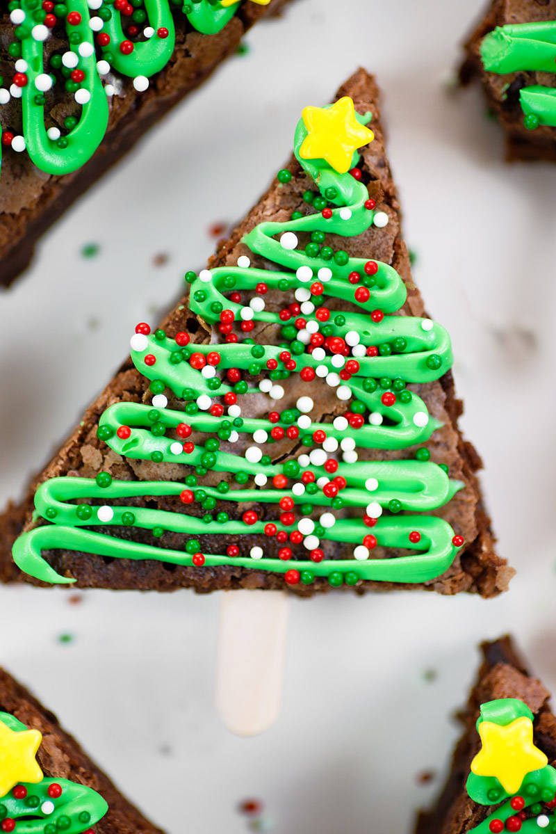 It's the most wonderful time of the year, and it's time to celebrate the season with these easy Christmas Tree Brownie Pops. Simple to make, and fun to eat, this festive dessert will be a hit at any holiday event!