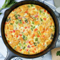 Want to be a brunch hero? Serve this Savory Smoked Gouda Veggie Frittata to truly impress your friends! So simple to make, it's perfect for Sunday brunch, lazy weekends, and family meals. {Recipe card and video included.}