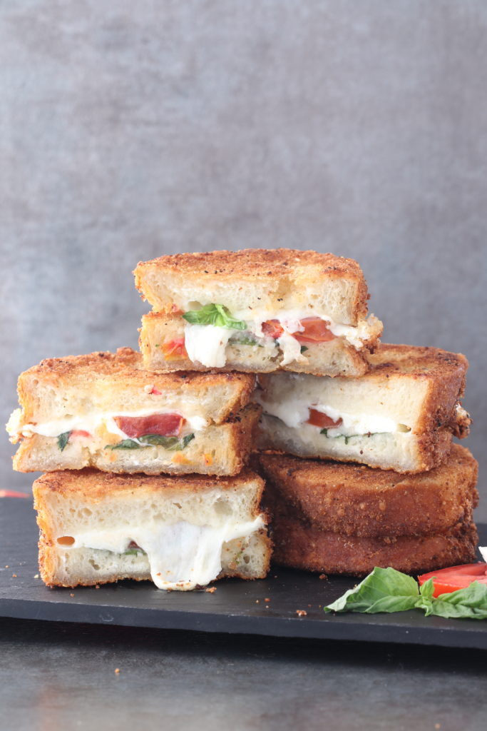 Treat yourself with this 15-Minute Fried Caprese Sandwich. This indulgent sandwich holds all of the flavors of your favorite salad fried to beautiful perfection in sour dough bread.