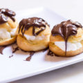 Have you ever tried French Cream Puffs? Profiteroles, as they're called in France, aren't your ordinary cream puffs. Filled with ice cream and doused in warm chocolate sauce, there is nothing more irresistibly indulgent!