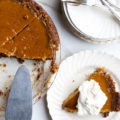 Whip up this Gluten-Free Walnut Crust Pumpkin Pie made from seasonal, roasted pumpkin and warming spices if you want to keep your holiday dessert menu fresh and healthy.
