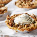 Need to serve a scrumptious dessert to a crowd, and you're worried about portion control and presentation? Mini Pecan Pies to the rescue! Topped with a homemade Pumpkin Spice Topping, this mini dessert recipe is sure to please at any gathering.