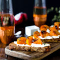 This Roasted Persimmon Burrata Crostini recipe will be the star of the show at your next get together. Roasted persimmon, creamy Burrata cheese, and fresh thyme top crunchy bread for an appetizer that's irresistible!