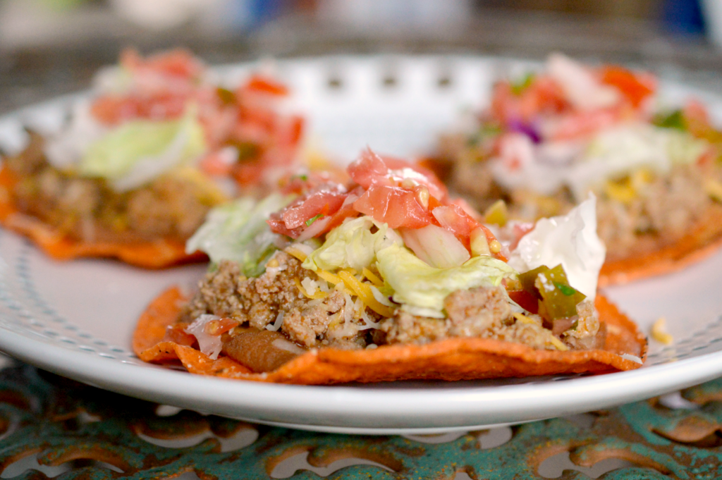 These awesome Tasty Turkey and Bean Tostadas are a sure-fire healthy meal on busy weeknights. Bursting with color, flavor, and crunch, your whole family will enjoy this simple no-fork-required meal!
