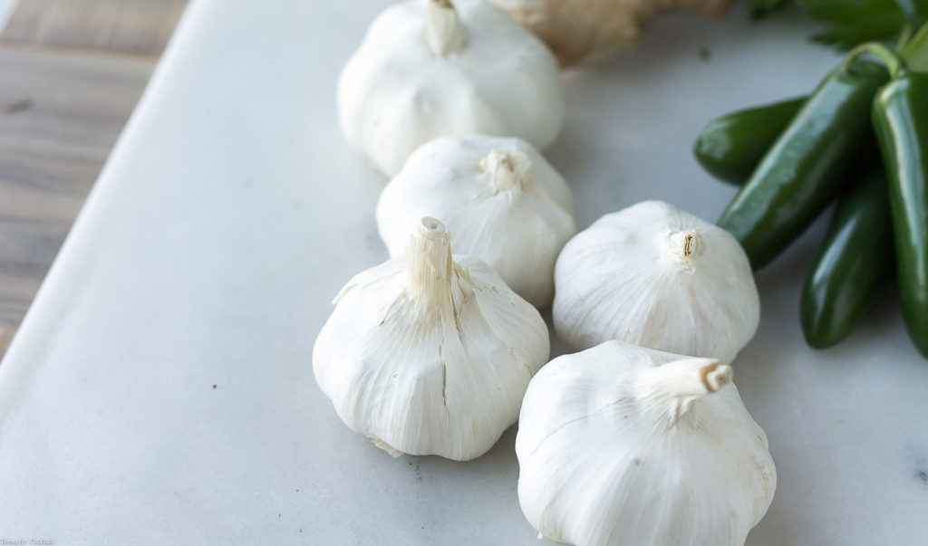 Garlic is the flavor foundation for many of your favorite recipes, but you may not be aware of its healthy properties. These five surprising garlic health benefits will make you turn to this aromatic ingredient even more!