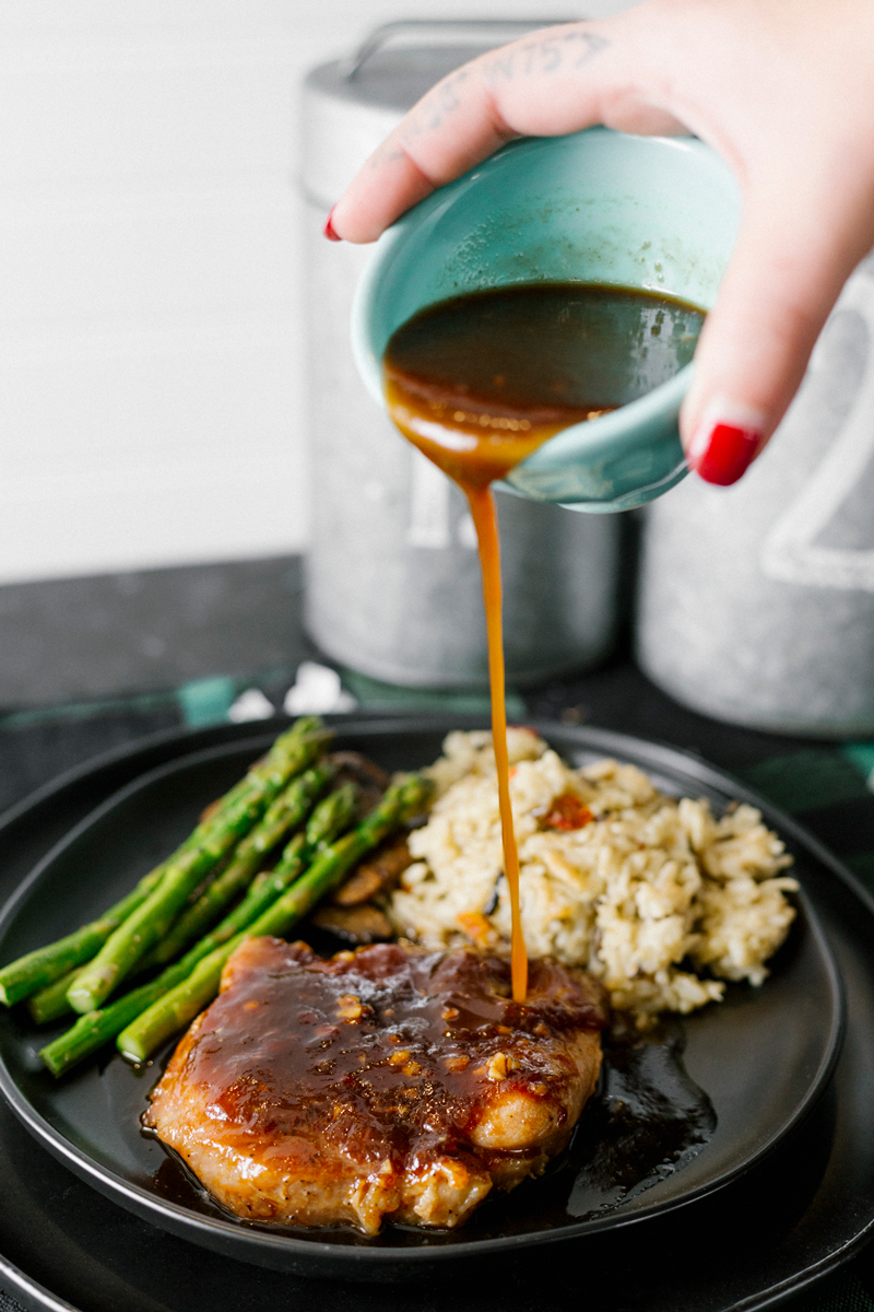 Easy, effortless, budget friendly, and ready in about 30 minutes, these Honey Garlic Glazed Pork Chops use kitchen staples for the sauce. Served with a side of asparagus, mushrooms, and rice, this meal is sure to impress!