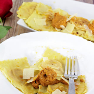 Make date night extra special with this Homemade Butternut Squash Ravioli served with Romesco Sauce. The time you take making it together in the kitchen is just as magical and memorable as the meal itself!