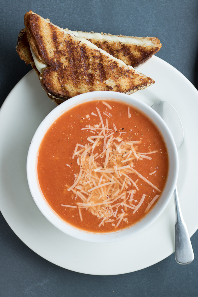 Just like mom used to make only better because the soup doesn't come out of a can, this healthy comfort food is a deli-style meal you'll love. Homemade Tomato Soup and Grilled Cheese is exactly the 30-minute meal your lunchtime needs!