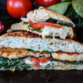 You're only six simple ingredients and 15 minutes away from a drool-worthy, deli-style meal. This Pesto Chicken Panini is a healthier classic you can make at home with chicken, pesto, spinach, Swiss, and tomatoes.