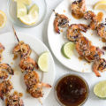 Grilled Teriyaki Sesame Shrimp uses fresh jumbo shrimp and a homemade teriyaki sauce. It's perfect as an appetizer for outdoor entertaining or on its own over rice as a weeknight meal. This shrimp on a stick is finger-licking good!