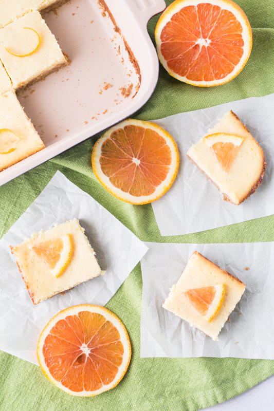 Impress family and friends with this easy dessert recipe. Only one bowl and a handful of ingredients makes this recipe for 6-Ingredient Orange Cheesecake Bars a winner every time. Cheat day just got a fresh citrus makeover!