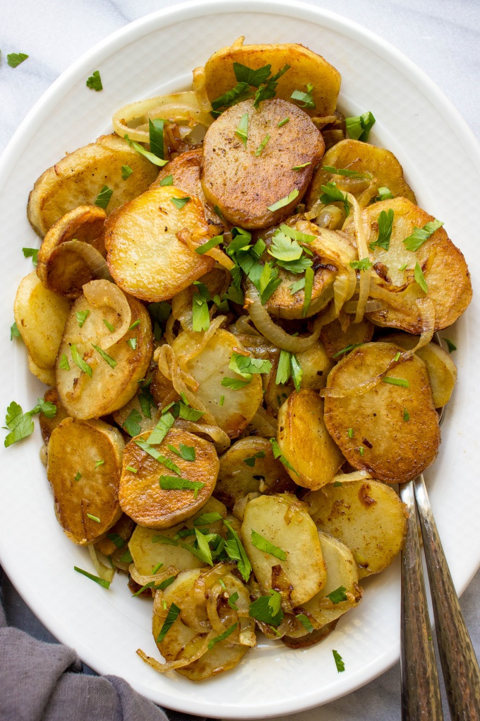 Need a versatile side dish perfect for a weeknight meal? These French Pan Fried Potatoes and Onions are the answer. Pair this 5-ingredient side dish with chicken, steak, pork, or fish!