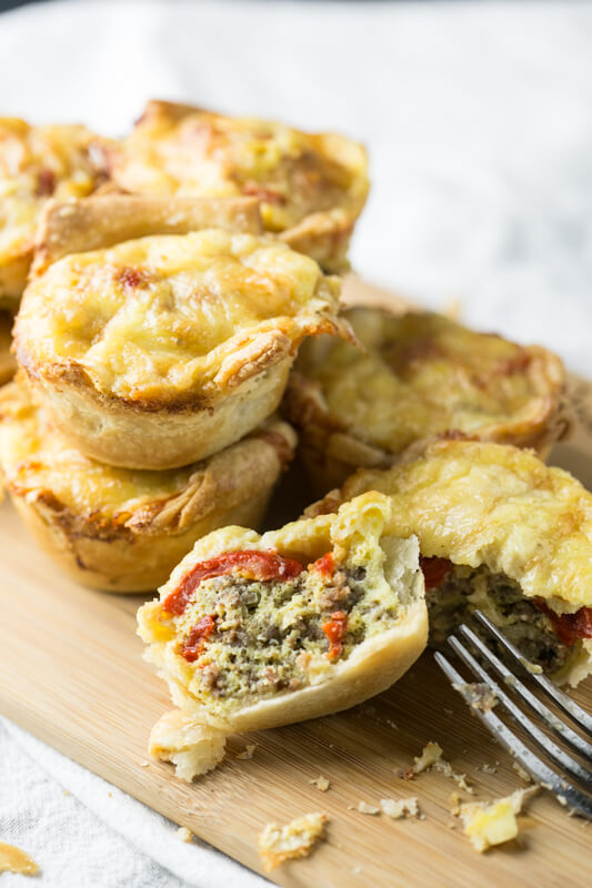 Your Sunday brunch needs these Red Pepper Sausage Brunch Mini Quiches! Everyone loves small bites and this savory 5-ingredient recipe delivers the perfect hand-held quiches fancy enough for brunch guests, but practical enough for on-the-go breakfast for the family!